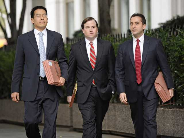 Assistant U.S. Attorneys, from left, Edward Kim, Sean Buckley and John Cronan leave Manhattan federal court in New York on Saturday.