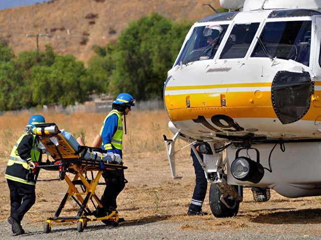 A 7-year-old boy with a medical problem was airlifted from Newhall to Children's Hospital Los Angeles on Saturday afternoon, according to a witness. (Rick McClure/For The Signal)