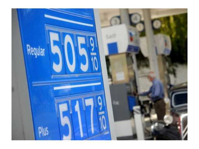 Gasoline prices higher than $5 per gallon are posted at a Menlo Park, Calif., Chevron station on Friday, Oct. 5, 2012. The recent surge in the price of gas has broken state records, according to AAA's Daily Fuel Gauge report.