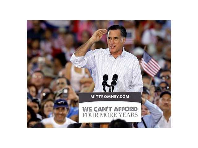 Romney cites 'job crisis' despite employment gains