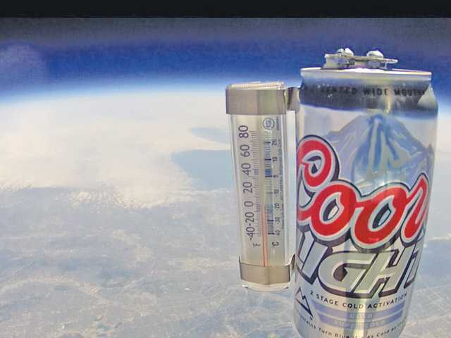 A photo of the Coors Light beer is captured from a GoPro camera as it climbs into space.
