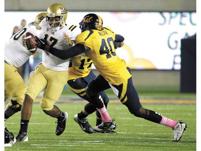 UCLA quarterback Brett Hundley (17) is sacked by California linebacker Chris McCain (40) on Saturday in Berkeley.