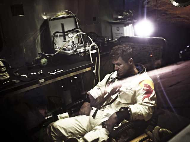 Pilot Felix Baumgartner sits in his trailer during the preparations for the final manned flight of the Red Bull Stratos mission in Roswell, N.M. on Saturday