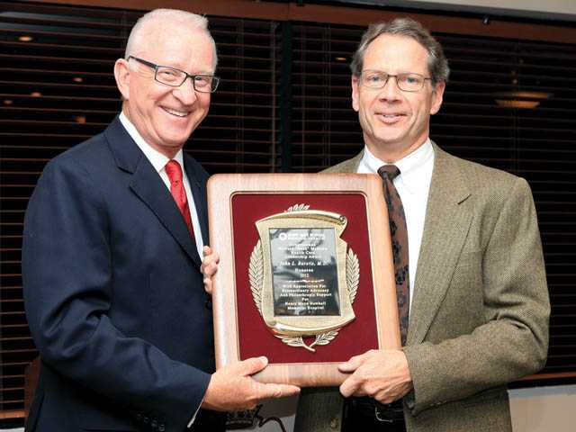 "Rep. Howard ""Buck"" McKeon presents his Healthcare Leadership Award to Dr. John Barstis at the Valencia Country Club."