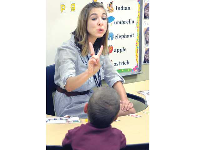Teacher Katarina Montano sounds out letters as she works with Imago Dei School students with developmental or learning disabilities at Trinity Classical Academy on Thursday.
