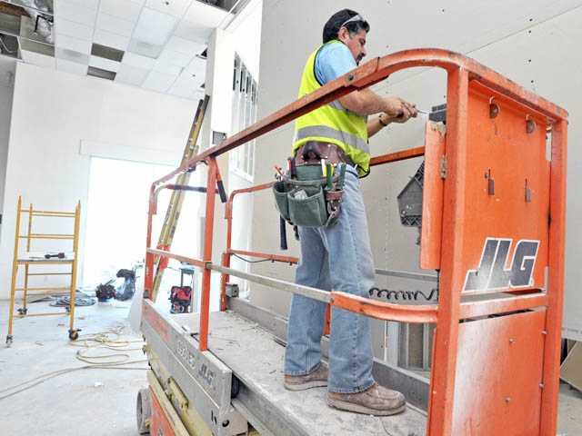 George Holguin works on paneling inside the soon-to-be Canyon Country Community Center on Monday. The construction is expected to be completed by winter.