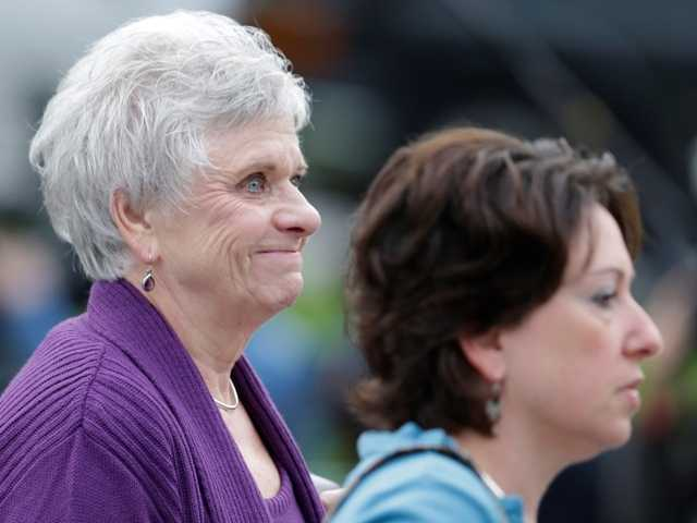 Dottie Sandusky, left, arrives at the Centre County Courthouse in Pennsylvania for her husband's sentencing.