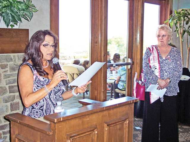 Soroptimist International of SCV President Sandi Naba introduces breast cancer awareness speaker Carole Hunt during Bras for a Cause event held at Tournament Players Club.