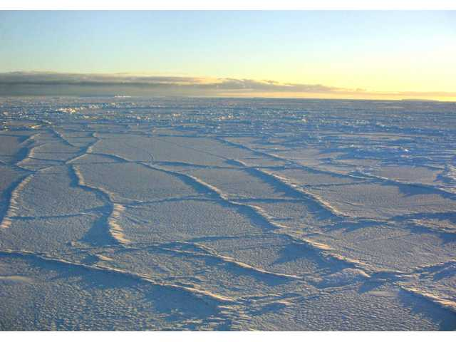 This handout photo provided by NSIDC, University of Colorado, taken in Oct. 2003, shows the Antarctic sunlight illuminating the surface of the sea ice, intensifying the effect of the fracture lines.
