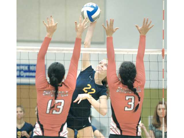 College of the Canyons' Kelsea Hundtoft (22) hits it through a Bakersfield block on Wednesday at College of the Canyons.
