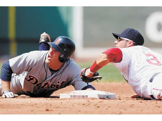 Detroit Tigers second baseman and Valencia graduate Danny Worth, left, slides into second base on May 28 in Boston.