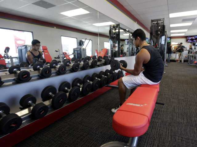 A customer works out at Snap Fitness Rolling Strong Gym at a truck stop in Dallas.