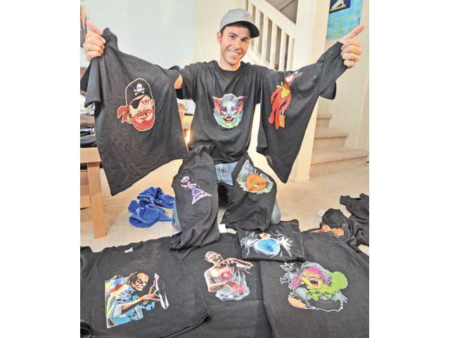 "Mark Rober displays his ""Digital Dudz"" T-shirt creations at his home in Valencia."