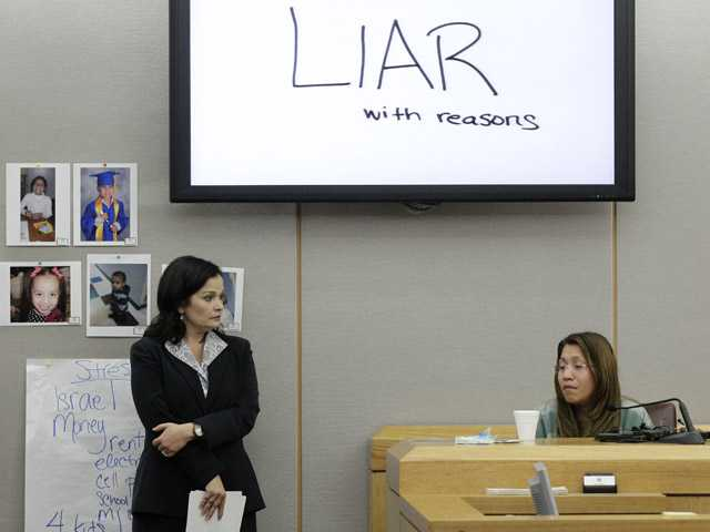 The words shown on a overhead display written by prosecutor Eren Price, left, are shown in court as Elizabeth Escalona, 23, responds to a line of questioning during her trial.
