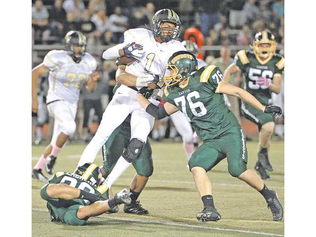 Golden Valley quarterback Chase Lewis (1) is brought down by Canyon defenders Liam Cabrera (20) and Ethan Allen (76) at Canyon High on Oct. 5.