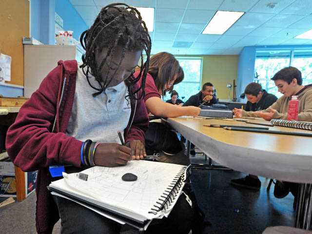 Ninth-grader Emily Ongele, 14, works on a two-point perspective drawing in an art class at the Albert Einstein Academy in Valencia on Wednesday.