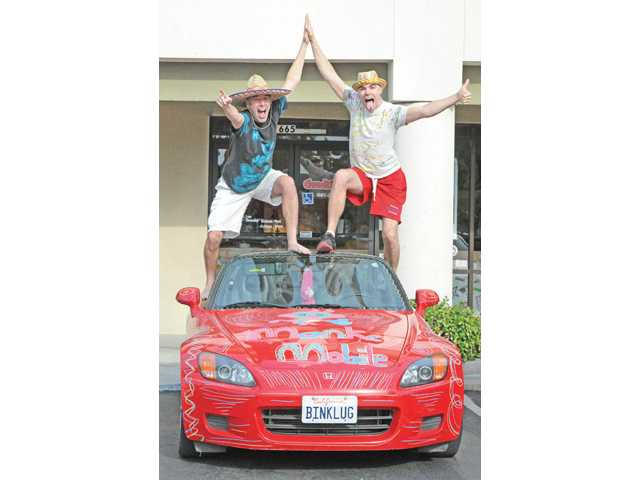 Brother Monkeys, John, left, and Jameson Scalia with their Brother Monkey Mobile at Chronic Tacos. in Saugus.