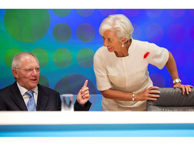 In this photo, IMF Managing Director Christine Lagarde, right, listens to German Finance Minister Wolfgang Schauble after filming a BBC special.