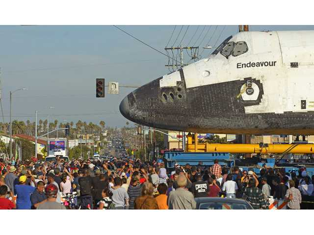 The space shuttle Endeavour is slowly moved down Crenshaw Blvd. at Slauson Ave., Saturday