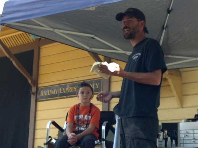 Kenneth Nolls, right, demonstrates a makeup technique he will use on 8-year-old Austin Rodriguez at Saturday's Pumpkin Festival in Newhall. Nolls has been doing makeup at the festival since 2007.