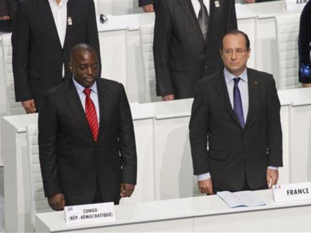 French President Francois Hollande, right, and Congolese President Joseph Kabila stand during the opening session of the Francophonie Summit, in Kinshasa, Congo, Saturday, Oct. 13, 2012. Hollande is taking part in a summit of French-speaking countries.