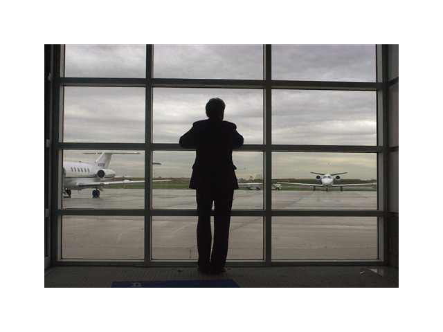 Sen. Arlen Specter, R-Pa. looks out toward the tarmac at the executive terminal of Philadelphia International Airport as he waits to board a plane.