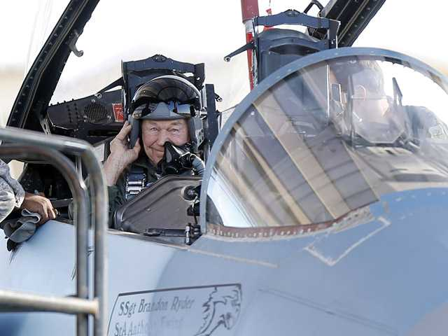 Retired Air Force Brig. Gen. Charles Yeager straps into an F-15D on Sunday for a re-enactment flight commemorating his breaking of the sound barrier 65 years ago, at Nellis Air Force Base, Nev.
