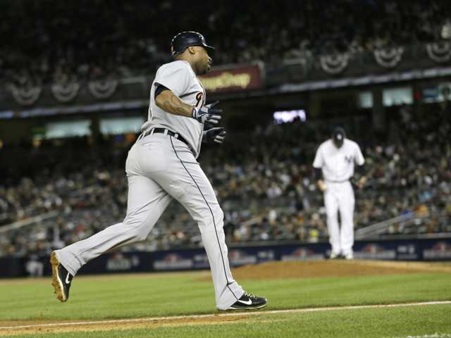 Detroit Tigers' Delmon Young rounds third base after hitting a solo home run off New York Yankees' Derek Lowe, rear, in the eighth inning during Game 1 of the American League championship series Saturday in New York.