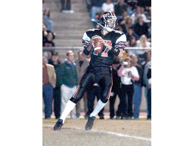 Matt Moore goes back to pass Dec. 7, 2001, in the CIF-Southern Section Division III championship game. Hart will retire Moore's No. 17 jersey before its Friday game at COC.