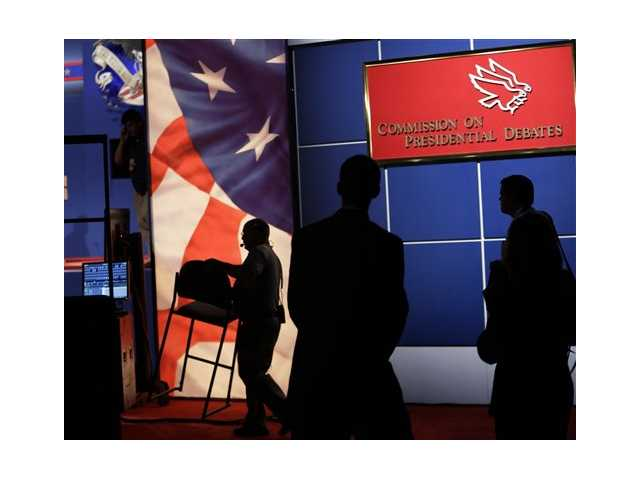 Workers prepare the set for the presidential debate on Tuesday.
