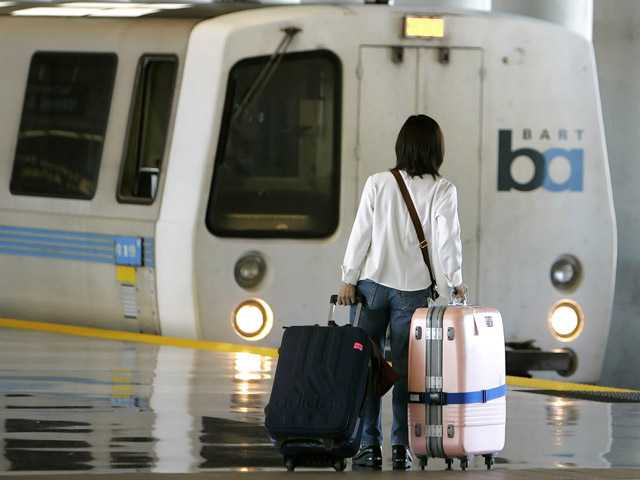 A departing passenger walks toward an outbound train at the San Francisco International Airport BART station in San Francisco.