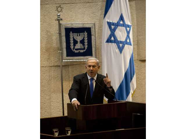 Israeli Prime Minister Benjamin Netanyahu gestures as he delivers a speech at the Knesset, Israel's parliament in Jerusalem on Monday.