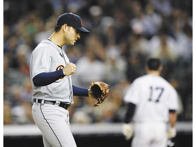 Detroit Tigers pitcher Anibal Sanchez reacts after striking out a New York Yankee on Sunday in New York.