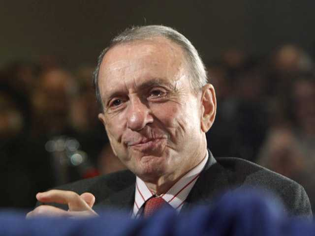 In this Sept. 30, 2009, photo, Sen. Arlen Specter, D-Pa., reacts to being acknowledged by President Barack Obama, who spoke National Institutes of Health in Bethesda, Md.