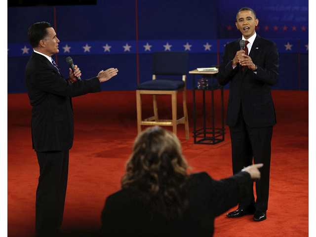Presidential nominee Mitt Romney and and President Barack Obama answer a question during the second presidential debate at Hofstra University.