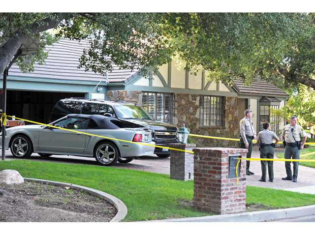 Sheriff's deputies work a scene where two bodies were found at a home at Heritage Lane and Maple Street in Newhall on Monday. (Jonathan Pobre/The Signal)