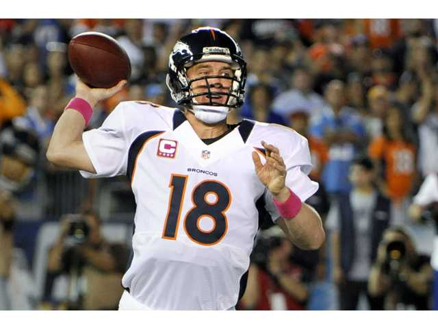 Denver Broncos quarterback Peyton Manning throws a pass against the San Diego Chargers on Monday in San Diego.