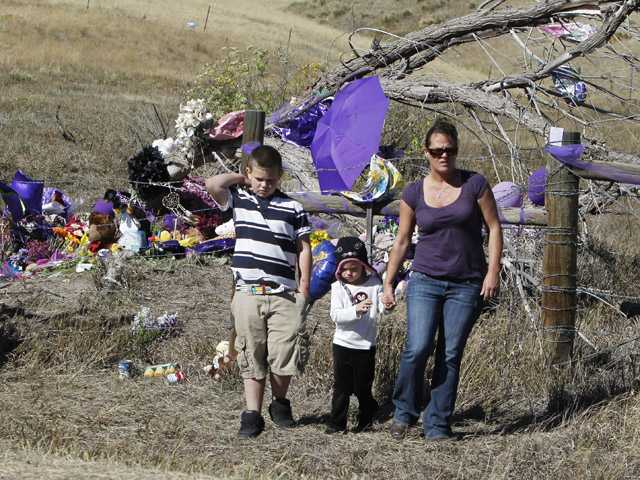 A woman and her children visit the open space park in Arvada, Colo., on Monday, where the body of 10-year-old Jessica Ridgeway was found.