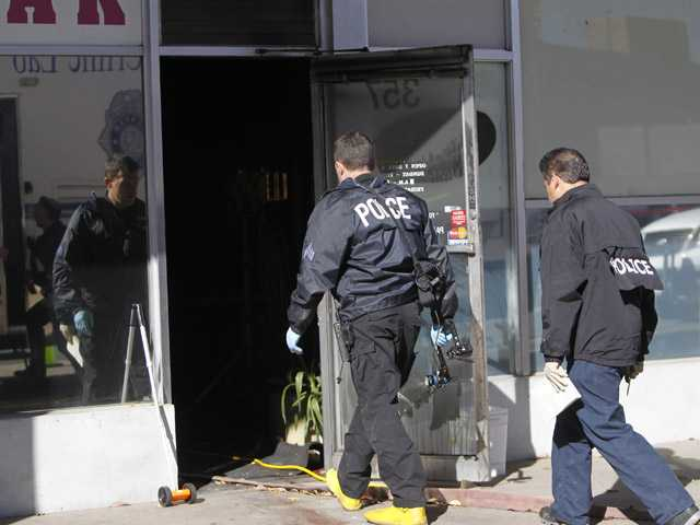 Police investigate at Fero's Bar and Grill in Denver, where five bodies were discovered after firefighters extinguished a fire Wednesday.