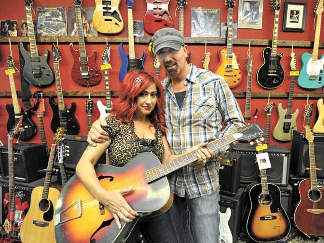 Gina and Louie Concotilli at Mugzey Muzic in Canyon Country. Louie Concotilli collected guitars for more than 20 years before opening the store.