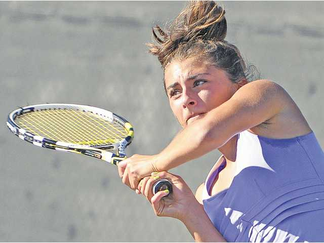 Valencia's Brigitta Benitez returns a shot against Hart at Valencia on Tuesday. Valencia defeated Hart 9-9 (71-69 in games).