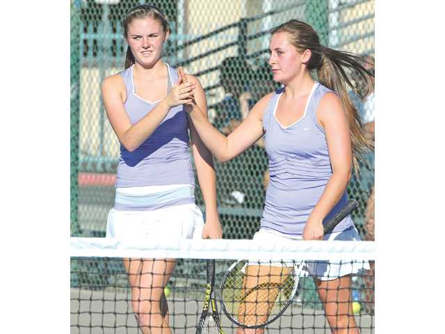 Valencia's doubles team of Ashley Keith, and Tina Inchalik celebrate its win against Hart at Valencia on Tuesday.