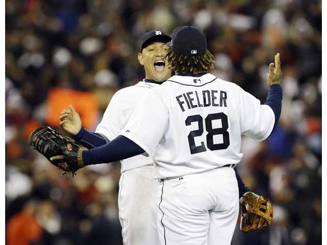 Detroit Tigers Miguel Cabrera and Prince Fielder (28) celebrate during a game agianst the New York Yankees on Tuesday in Detroit.