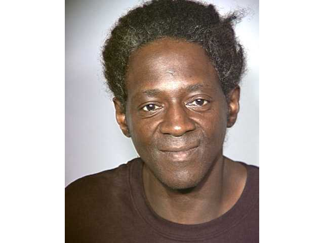 This police booking file photo released by the Las Vegas Police Department, shows rapper and reality television star Flavor Flav after his arrest.