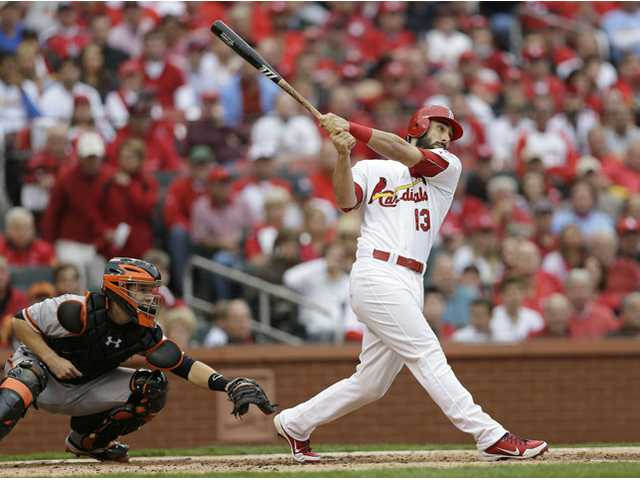 St. Louis Cardinal Matt Carpenter (13) watches the ball as he hits a two-run home run against the San Francisco Giants on Wednesday in St. Louis.