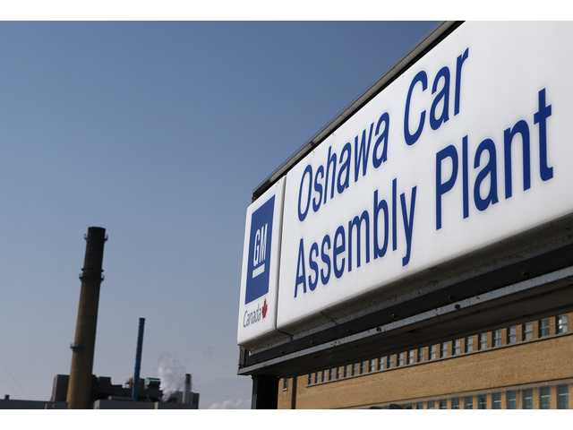 A sign stands outside Oshawa's General Motors car assembly plant in Oshawa, Ontarrio.