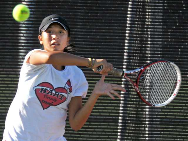 Hart singles player Proyfon Lohaphaisan returns a shot against Canyon on Thursday at Hart High School.