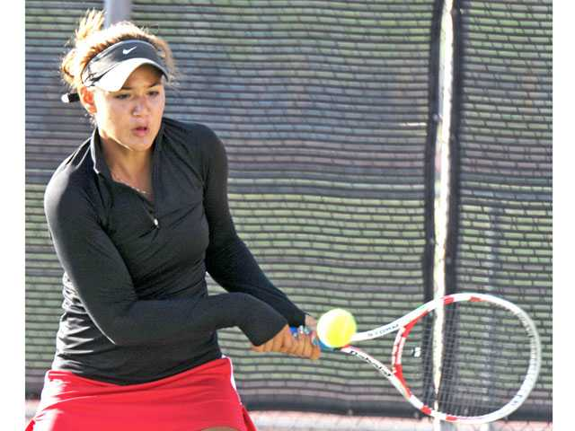 Hart freshman Natalia Munoz hits a return against Canyon on Thursday at Hart High School.