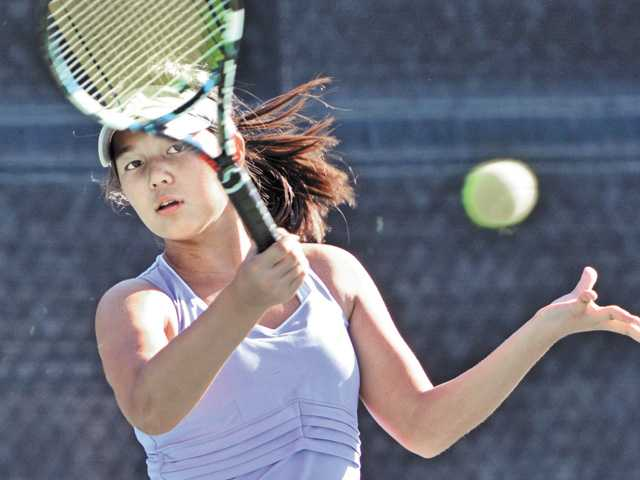 Valencia singles player Sabrina Wueste stares down her shot during a match on Thursday against West Ranch at West Ranch High School.