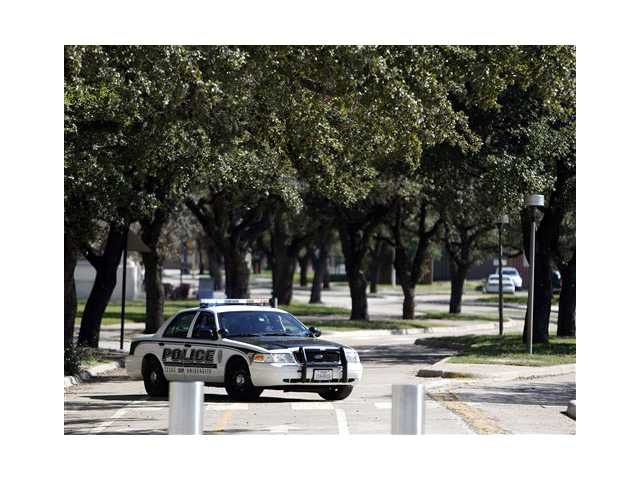 Texas A&M police block access to the Texas A&M campus while authorities investigate a bomb threat Friday in College Station, Texas.